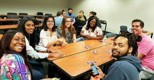 Campus MPH students play Uno.